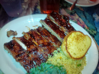 Large American portion of a rack of ribs for dinner