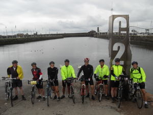 Group of people on their bikes about to start their coast to coast holiday